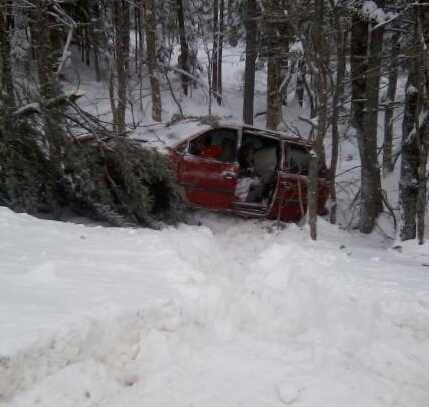 A mother and one of her children suffered injuries after their van slid off Route 11 on Thursday afternoon, rolled twice and struck a tree. Two other children in the van were uninjured.