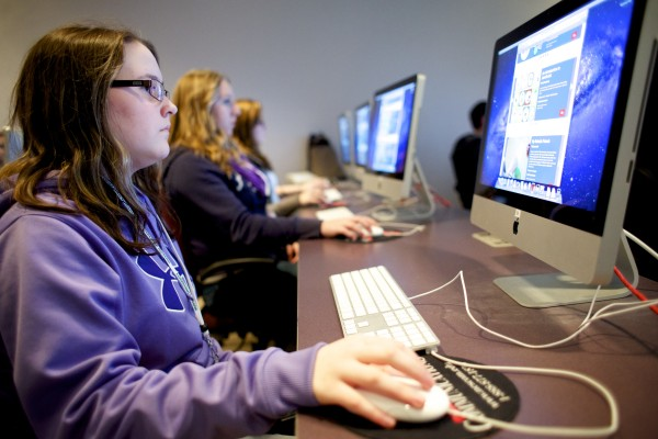 "Hermon High School Freshman Elise Sides, 14, joins in the &quotHour of Code&quot Wednesday morning at NESCOM. Husson University and NESCom both partook in  the ""Hour of Code"" where Hermon High School students were introduced to computer sciences."