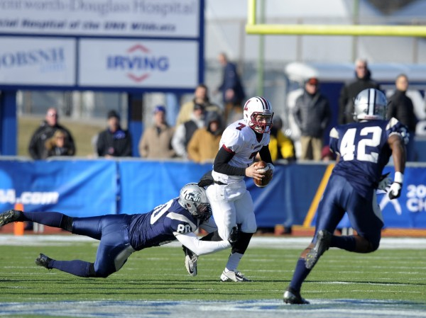 New Hampshire Wildcats defensive end Cam Shorey (80) sacks Lafayette Leopards quarterback Drew Reed (7) during the first half at Cowell Stadium.