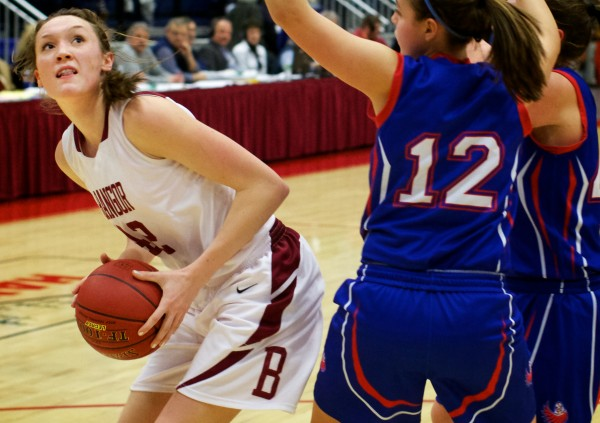 Bangor High School forward Mary Butler (left) looks to the basket around Mt. Ararat High School's Caitlin LaFountain in this February 2013 file photo.