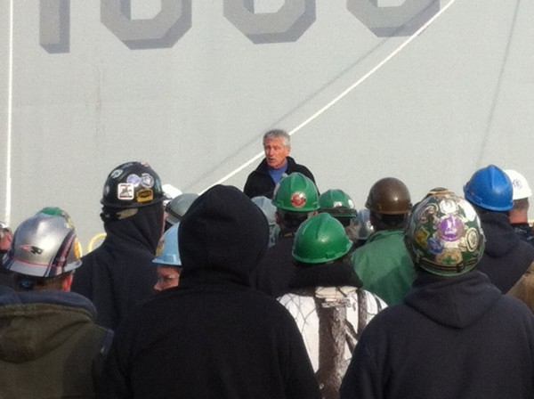 Secretary of the Navy Chuck Hagel speaks to shipbuilders and the crew of the DDG-1000 at Bath Iron Works last month.