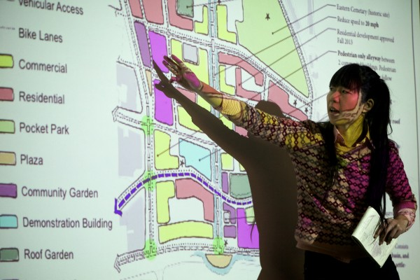 Sahoko Yui, a graduate student at the University of California Davis, helps lay out a sustainable identity plan for the India Street neighborhood at public presentation on Monday. The plan includes pocket parks, community gardens and turning half of Franklin Street into a bike path.