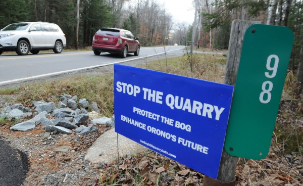 A sign against opening up a quarry at the end of Kelley Road is seen at the end of a driveway on Stillwater Ave in Orono in this November 2013 file photo.