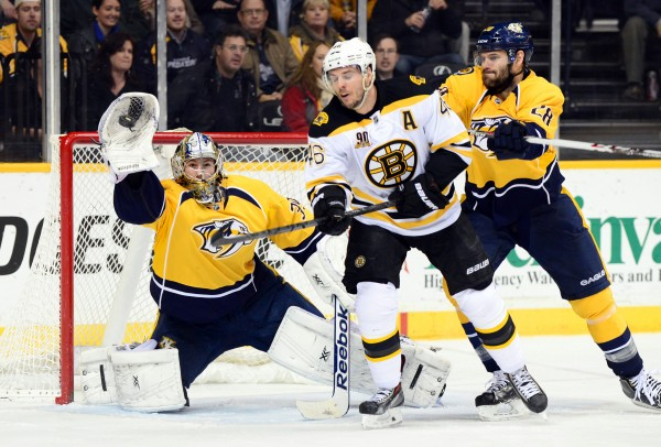 Nashville Predators goalie Marek Mazanec (39) makes a save as Boston's David Krecji looks for a deflection during the second period of Monday night's NHL game at Bridgestone Arena. The Bruins won 6-2.