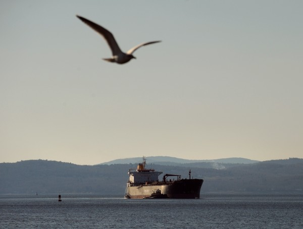 A ship is guided into the Sprague Energy Terminal at Mack Point by tugboats off Searsport.