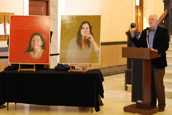 Robert Shetterly of Brooksville unveils two portraits of Maine Indian advocates Denise Altvater, left, and Esther Attean, the newest additions to his &quotAmericans Who Tell The Truth&quot series, at the Hall of Flags Wednesday.