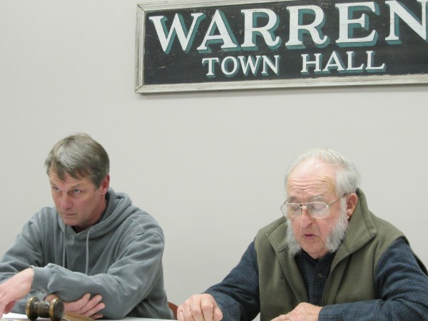 Doug Pope, left, the chairman of the Warren Board of Selectmen, and Selectman Arnold Hill listen to people speak Monday night concerning ambulance coverage for the town.