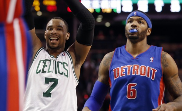 Boston Celtics power forward Jared Sullinger (7) reacts to missing a foul shot late in the fourth quarter as Detroit Pistons small forward Josh Smith (6) looks on in Detroit's 107-106 win at TD Garden in Boston Wednesday night.