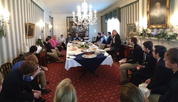 In this panorama photo, Gov. Paul LePage, near center, in pink shirt, talks with students from Bowdoin College in the State Dining Room. The governor had invited the students to a lunch meeting to discuss how to attract young people to Maine, and keep them here.