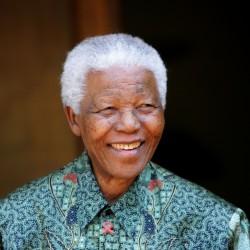 Former South African President Nelson Mandela greets photographers in Johannesburg in 2005.