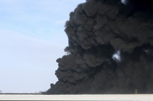 A plume of smoke rises from scene of a derailed train near Casselton, N.D., Monday.