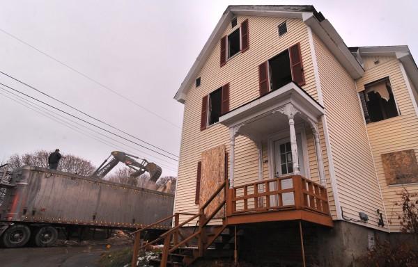 Crews work on demolishing buildings on First Street in Bangor Tuesday afternoon.