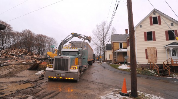 Crews work on demolishing buildings on First Street in Bangor Tuesday afternoon.