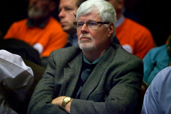Bob Metcalf, of Mitchell & Associates, listens to one of the 50 speakers during the public comment portion of Portland's Planning Board meeting Tuesday night as it wrestled with the fate of the $150-million Midtown project.