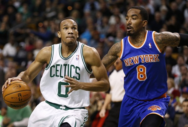 Boston Celtics point guard Avery Bradley (0) dribbles the ball as New York Knicks shooting guard J.R. Smith (8) defends during the second half at the TD Garden in Boston Friday night.