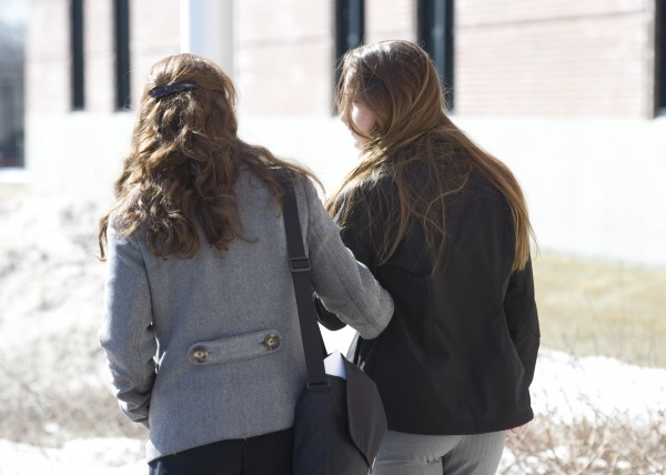 May Callahan (right) and her mother Dawn leave the Penobscot Judicial Center in Bangor on Tuessday after May's sentencing for the felony terrorizing of Lexi Henkel and her family of Orono in this March 2013 photo.