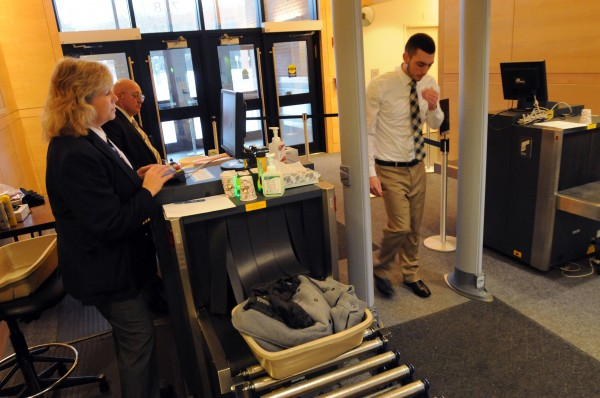 Maine State Judicial Marshals Kathy Beal and Tom Rowe scan a visitor to the Penobscot Judicial Center in Bangor on Monday.