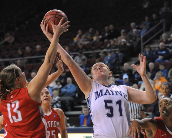 The University of Maine's Anna Heise (right) and Hartford's Taylor Clark battle for a rebound during the game at the Cross Insurance Center in Bangor Wednesday.