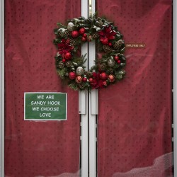 A sign is taped to the front window of a business in the Sandy Hook section of Newtown, Connecticut December 15, 2013. Locals have been striving to return to normal even as yesterday marked the one year anniversary of the shooting rampage at Sandy Hook Elementary School, where 20 children and six adults were killed by gunman Adam Lanza.