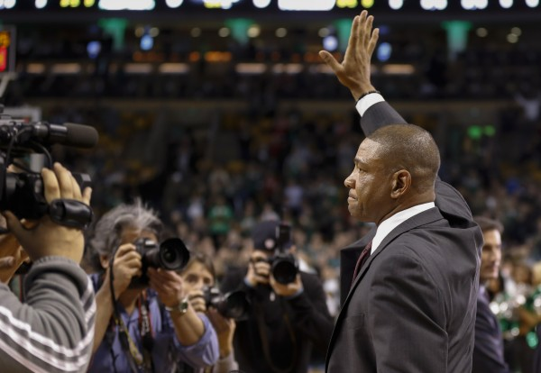 Los Angeles Clippers head coach Doc Rivers waves to the crowd as he takes the floor before the game against the Boston Celtics at TD Garden in Boston Wednesday night.
