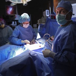 Questions arise about robotic surgery's cost, effectiveness