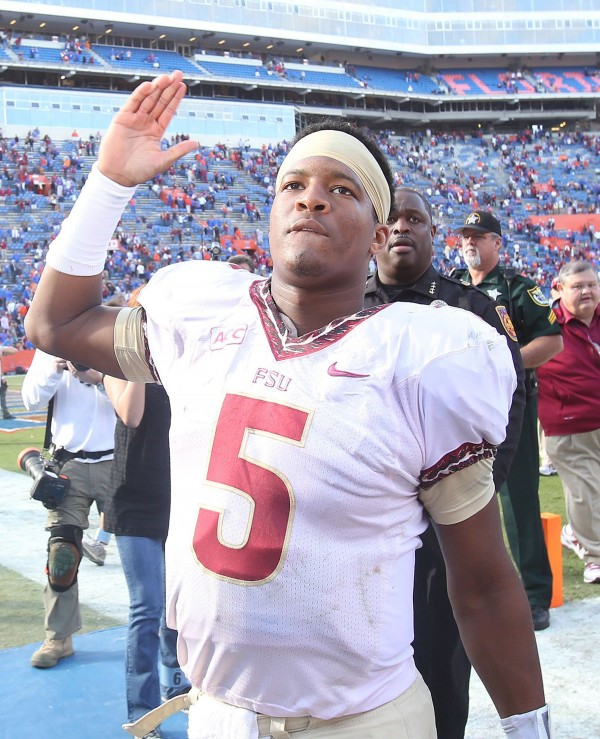 Florida State Seminoles quarterback Jameis Winston celebrates at the end of the game against the Florida Gators at Ben Hill Griffin Stadium in Gainesville, Fla., on Saturday, Nov. 30, 2013.