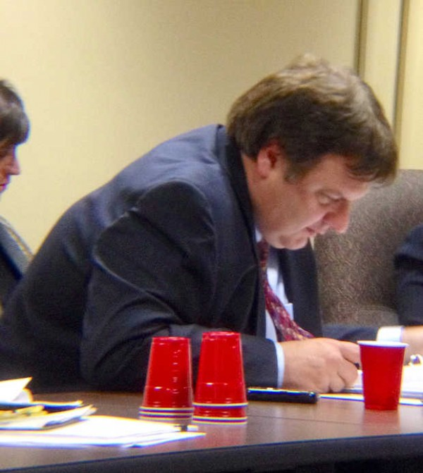 Peter Robinson of Lewiston reviews a document during a hearing before the state's ethic commission on a failed 2011 campaign for a casino in Lewiston. Robinson served as the treasurer for a political action committee that worked in favor of the campaign.