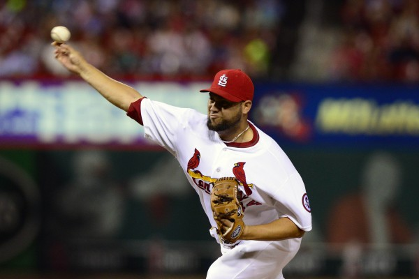 St. Louis Cardinals relief pitcher Edward Mujica throws to a Houston Astros batter during a game in July in St. Louis.
