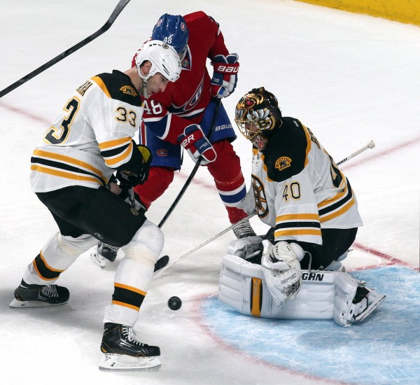 Boston Bruins goalie Tuukka Rask (40) makes a save against Montreal Canadiens center Daniel Briere (48) as defenseman Zdeno Chara (33) defends during the second period at the Bell Centre in Montreal Thursday night.