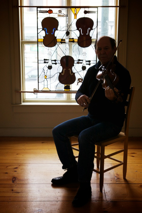Violin maker Jonathan Cooper plays &quotNapoleon Crossing the Rhine&quot on an instrument he made in his Portland workshop on Friday. Cooper makes custom instruments for classical players as well as traditional fiddlers.