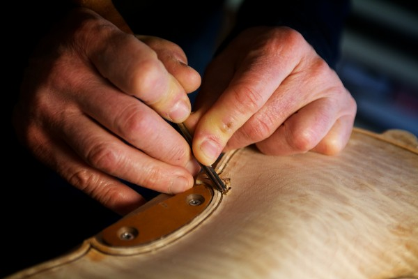 Jonathan Cooper, who studied violin construction in Cremona, Italy, works on an instrument in his Portland workshop on Thursday.