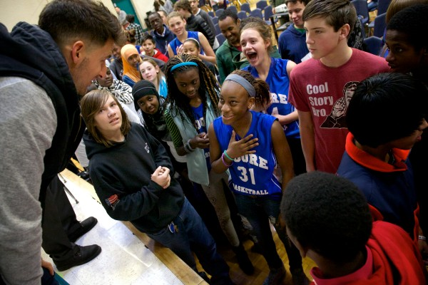 Ryan Flaherty, an infielder for Major League Baseball's Baltimore Orioles, speaks with students at Lyman Moore Middle School in Portland on Thursday. Flaherty told students at his alma mater they didn't need to be the biggest, strongest or most popular in order to achieve their dreams.