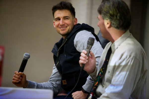 Major League Baseball player Ryan Flaherty smiles at his old principal, Steve Rogers, Thursday as he showed students at Lyman Moore Middle School in Portland a video of Flaherty hitting a grand slam against the Red Sox.
