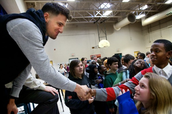 Ryan Flaherty, an infielder for Major League Baseball's Baltimore Orioles, shakes hands with students at Lyman Moore Middle School in Portland on Thursday. Flaherty told students at his alma mater they didn't need to be the biggest, strongest or most popular in order to achieve their dreams.