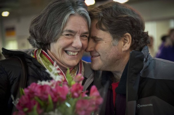 Greenpeace Capt. Peter Willcox meets his wife, Maggy, at the St. Petersburg Airport recently in Russia. Willcox has been detained in the country since September after being arrested during a protest against oil drilling in the Arctic.