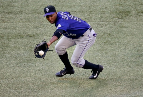 Colorado Rockies shortstop Jonathan Herrera (18) makes the play on a grounder in the second inning against the Toronto Blue Jays at Rogers Centre on June 17, 2013.