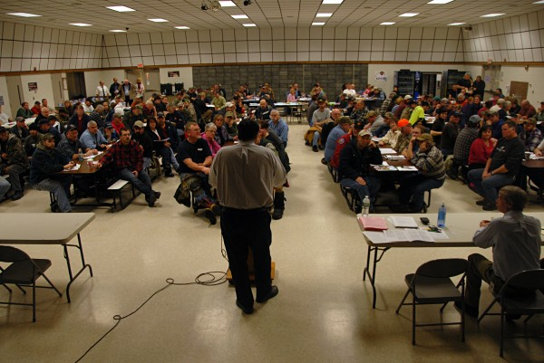 More than 200 workers at Lincoln Paper and Tissue LLC listen as state Department of Labor and union officials brief them on unemployment benefits during a meeting at Mattamawcook Academy of Lincoln on Thursday.
