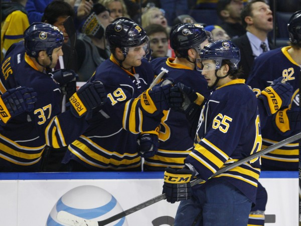 Buffalo Sabres right wing Brian Flynn (65) celebrates his first-period goal against the Boston Bruins at First Niagara Center in Buffalo Thursday night. Flynn is a former University of Maine standout.