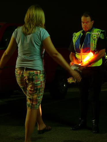 A Bangor Police Officer performs a field sobriety test on a woman after a traffic stop.