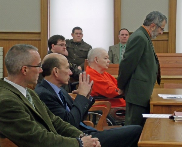George Jaime (wearing orange) listens as his defense attorney, Jeffrey Silverstein of Bangor, argues for a new trial in Aroostook County Superior Court in Houlton on Friday, Dec. 20, 2013. Jaime, 76, was sentenced to 40 years in prison for the intentional and knowing murder of Starlette Vining, who was 38 years old when she was last seen alive in October 1998. Her body was never found. At the prosecution table is (at right) State Police Detective Adam Stoutamyer, the primary detective on the case, and Assistant Attorney General Andrew Benson.