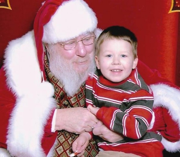 Independent State Rep. Joe Brooks of Winterport, who was hired this year to serve as Santa for the Bangor Mall, was fired Thursday night. He is pictured with his then 3-year-old grandson, Tyler Greenleaf, in a picture taken at the Bangor Mall last year.