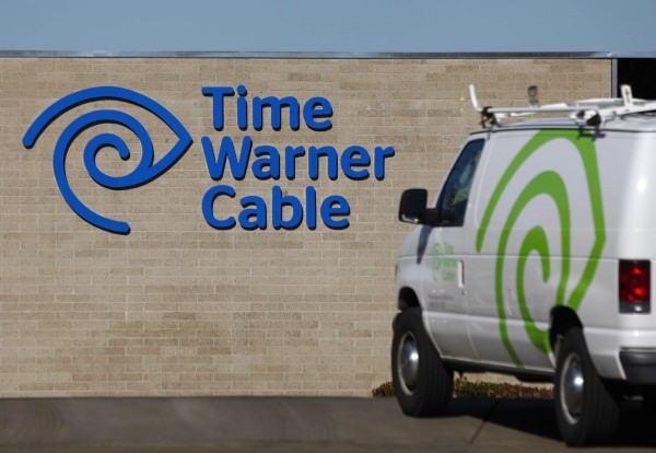 A cable truck is parked at a Time Warner Cable office in San Diego, Calif., earlier this month. Time Warner has decided not to drop NECN from its lineup, reversing an early decision.