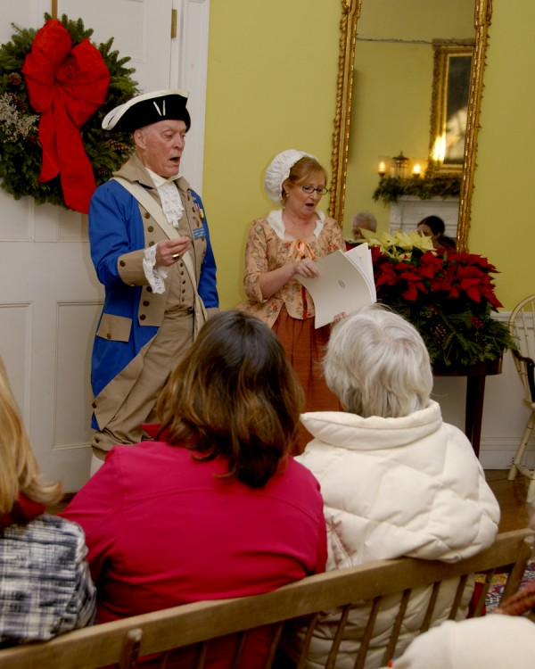 Dressed in colonial-era fashions, volunteers Harry Grant and Mary Kay Felton lead visitors in Christmas caroling during the Holiday Open House at Montpelier on Saturday. Montpelier is the replica General Henry Knox mansion and is the site of the General Henry Knox Museum. Felton is a docent and a member of the Friends of Montpelier's collections committee.