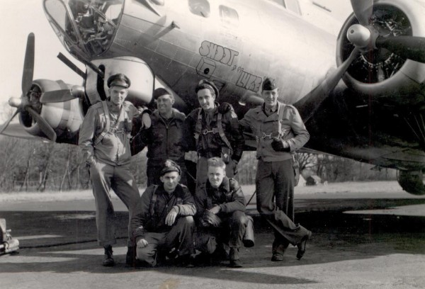 Tech. Sgt. Lyman Blackwell (kneeling, right) poses in front of a B-17 with some of his fellow crew members. Blackwell was on his way to bomb Germany in the closing years of World War II when his crew was stranded in Bangor around Christmastime due to ice. Bangor residents threw the crew a party on Christmas Even, and Blackwell to this days calls it one of the best Christmases he ever had.