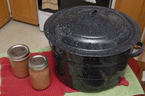 A Dutch oven is a key utensil used in the preparation of homemade applesauce.