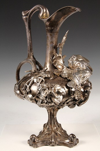 English Victorian sterling silver ewer with applied cast figural decoration by London silversmith Joseph Angell II that fetched $5,750