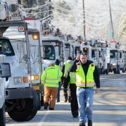 Utility crews fight losing battle against ice