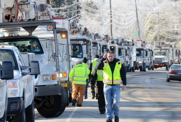 Crews from various companies line Route 1 in Bucksport before clearing icy lines of limbs from the weekend storm.