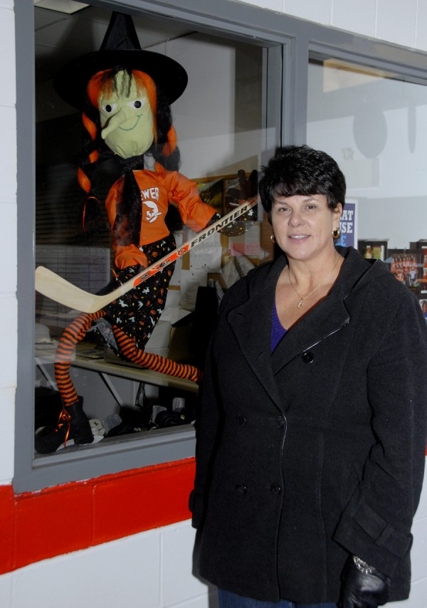 Linda Bishop, a co-owner of the Penobscot Ice Arena, stands beside a Brewer Witches' hockey mascot inside the ice rink at 90 Acme Road. Bishop and her husband, George, own Penobscot Cleaning Services in Brewer; the Bishops purchased Penobscot Ice Arena in late September 2013.
