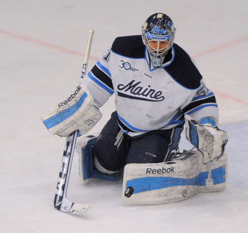 The University of Maine's goalie Martin Ouellette makes a save during the first period game against American International in Orono Friday.